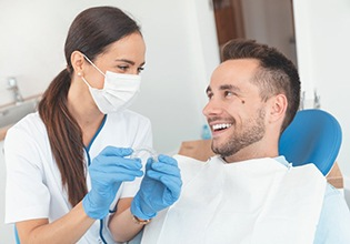 Patient and doctor discussing Invisalign in Ware.
